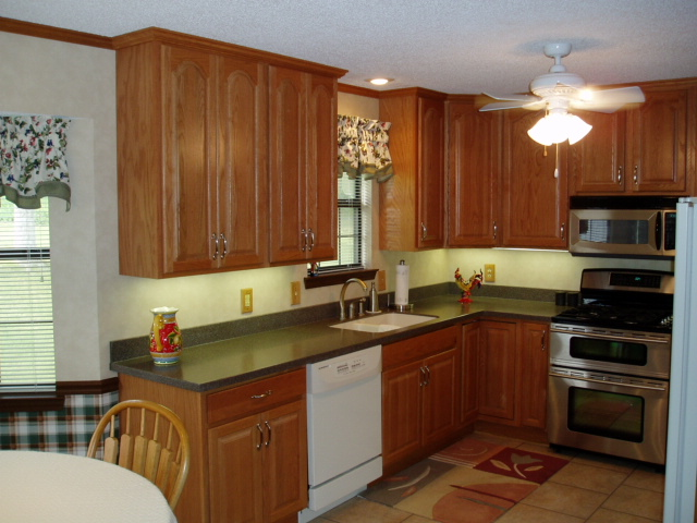 Half wall & spindals removed, new full-height oak Heritage cabinetry, Corain sink & countertop